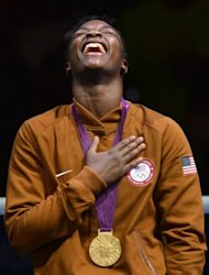Gold medalist Claressa Shields of the USA celebrates with the gold medal on the podium of during the women's boxing Middleweight (75kg) of the 2012 London Olympic Games at the ExCel Arena in London. Shields restored some pride to American boxing when she beat Russia's Nadezda Torlopova 19-12