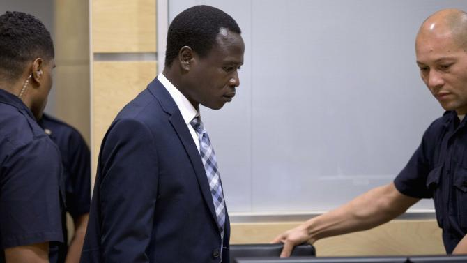 Dominic Ongwen, a commander of the Ugandan LRA, takes his seat during his first appearance at the ICC in The Hague