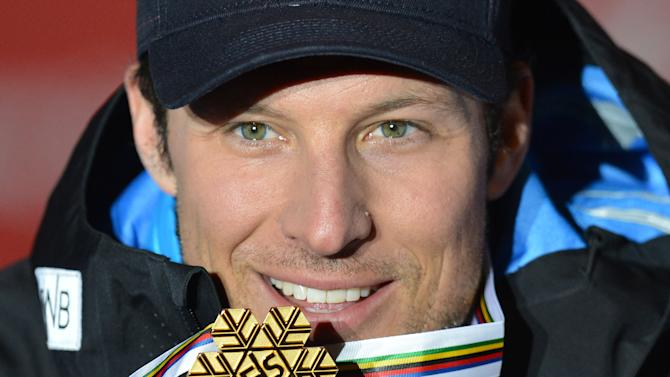 Norway's Aksel Lund Svindal poses with his gold medal during the medal ceremony after the men's downhill race at the Alpine skiing world championships in Schladming, Austria, Saturday Feb. 9, 2013. (AP Photo/Kerstin Joensson)