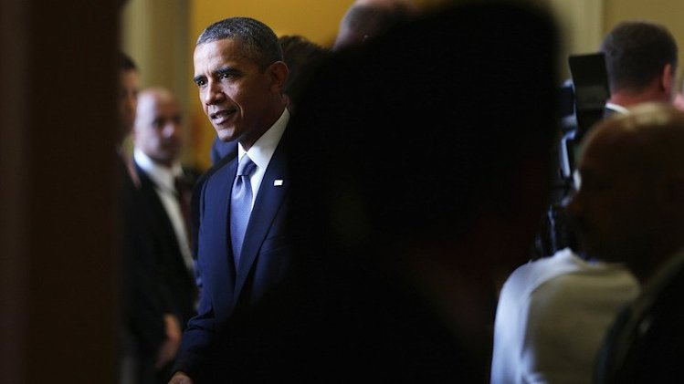 US President Barack Obama talks to Senate pages at the Capitol on September 10, 2013 in Washington, DC