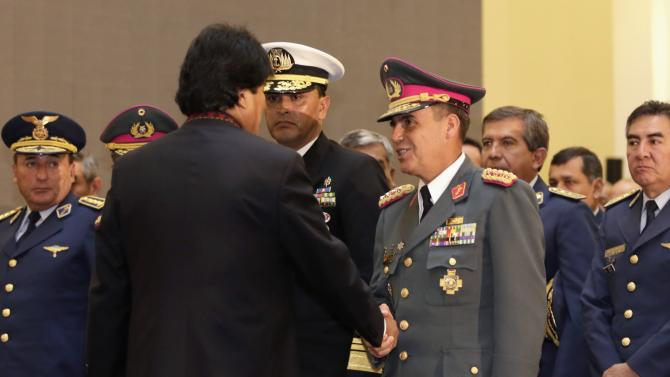 Bolivia's President Morales shakes hands with Army General Salinas, new chief commander of Bolivia's military forces, during a swearing-in ceremony in La Paz