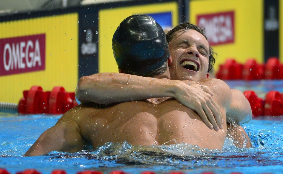 Brendan Hansen, left, is congratulated by Eric Shanteau after winning the men's 100-meter breaststroke final at the U.S. Olympic swimming trials, Tuesday, June 26, 2012, in Omaha, Neb. (AP Photo/Mark J. Terrill)