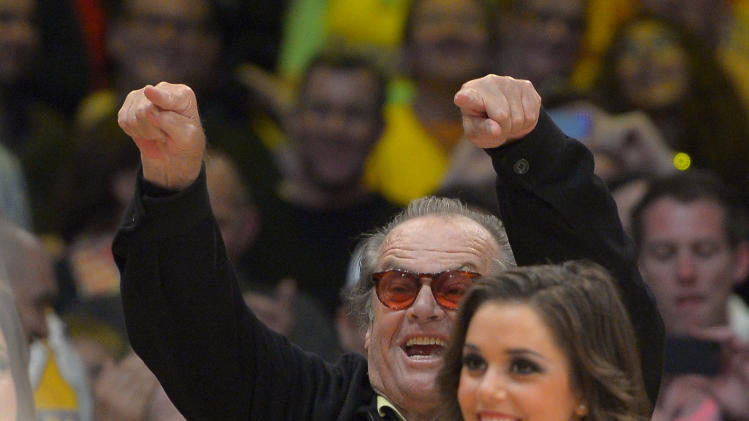 Actor Jack Nicholson points to former Los Angeles Lakers center Shaquille O'Neal as they retire his jersey during the half of the Lakers' NBA basketball game against the Dallas Mavericks, Tuesday, April 2, 2013, in Los Angeles. (AP Photo/Mark J. Terrill)