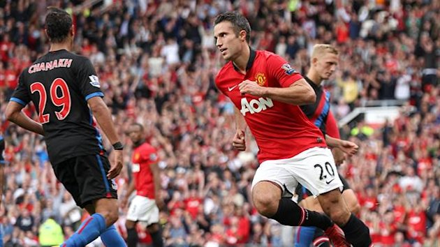 Manchester United's Robin van Persie celebrates scoring his teams first goal of the game from the penalty spot (PA Photos)