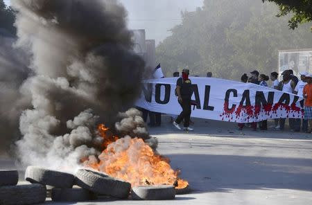 Demonstrators block the Panamerican highway to protest against the Grand Canal construction in Managua