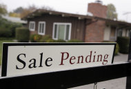 <p>               This Nov. 27, 2011 photo, shows a home with a sale pending sign in Palo Alto, Calif. The number of Americans who signed contracts to buy homes jumped in October to the highest level in a year. (AP Photo/Paul Sakuma)
