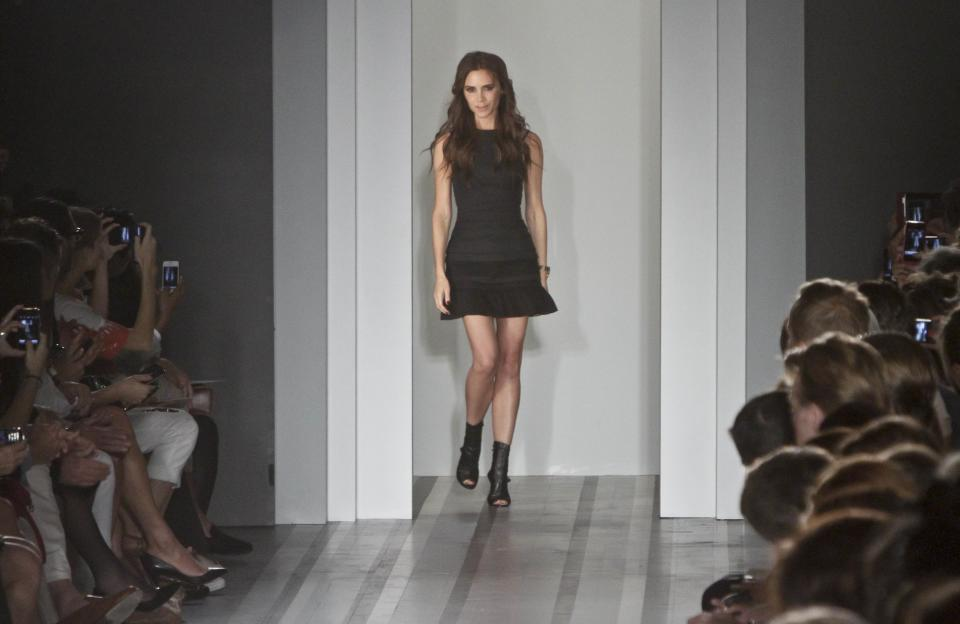 Victoria Beckham appears after showing her Spring 2013 fashion collection on Sunday, Sept. 9, 2012 in New York.  (AP Photo/Bebeto Matthews)