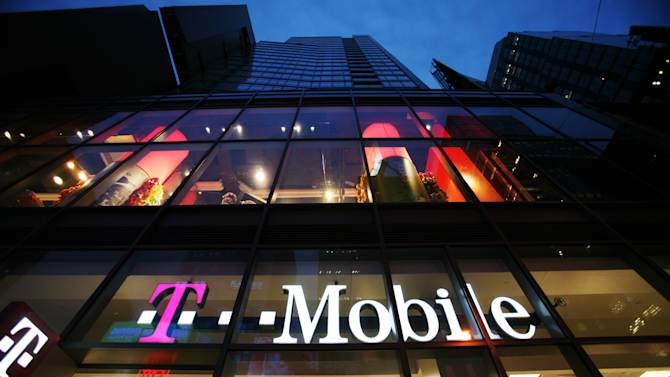 In this March 18, 2008 photo, a T-Mobile retail store is shown in Times Square in New York.  U.S. consumers have had their fill of expensive, contract-based phone plans. Figures from T-Mobile USA on Thursday,May 10, 2012,  added to earlier reports from other companies, indicate that the U.S. wireless industry lost subscribers from contract-based plans for the first time in the first quarter. Contract-based plans are the most lucrative ones for phone companies. The industry default over the past several decades, they account for the vast majority of revenue at the big phone companies. (AP Photo/Mark Lennihan)