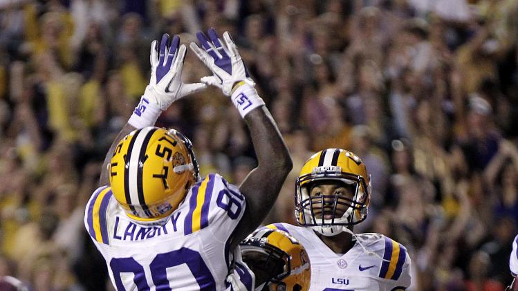 LSU wide receiver Jarvis Landry (80) celebrates his touchdown reception with running back Jeremy Hill (33) and wide receiver Odell Beckham (3) in the first half of their NCAA college football game against Mississippi State in Baton Rouge, La., Saturday, Nov. 10, 2012. (AP Photo/Gerald Herbert)