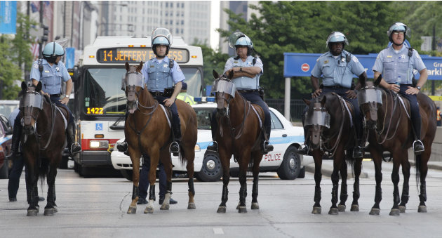 Chicago police department mounted patrol monitors the area as protesters march through the city during a NATO summit demonstration in downtown Chicago, Saturday, May 19, 2012. Security has been high t