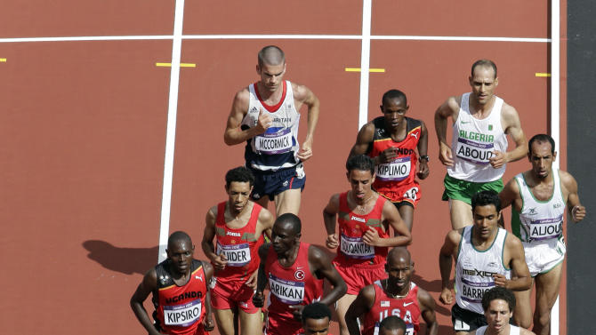 United States'  Galen Rupp, front left, and Ethiopia's Dejen Gebremeskel lead the pack midway through the men's 5000 meters during the athletics in the Olympic Stadium at the 2012 Summer Olympics, London, Wednesday, Aug. 8, 2012. (AP Photo/Mark Duncan)
