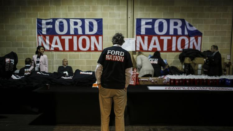A man wears a Toronto Mayor Rob Ford campaign shirt during Ford's campaign launch party in Toronto