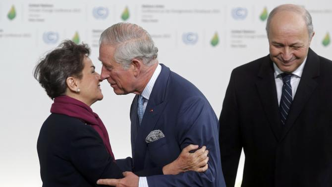 Secretary of the UN Framework Convention on Climate change Figueres welcomes Britain's Prince Charles with French Foreign Affairs Fabius for the opening day of the World Climate Change Conference 2015 (COP21) at Le Bourget