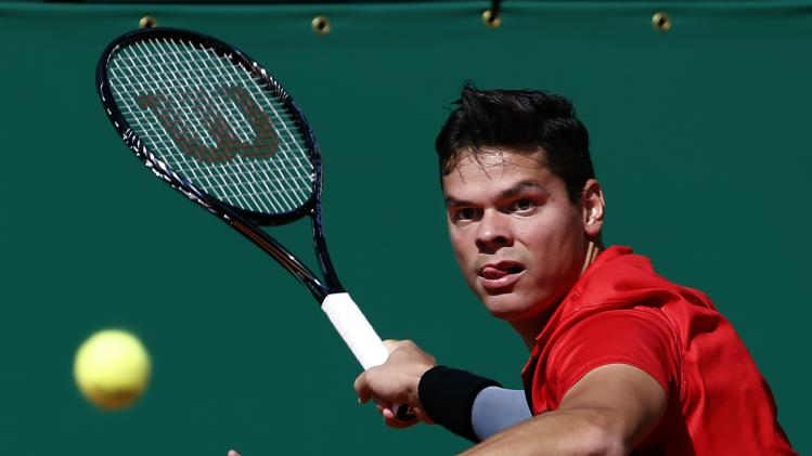 Milos Raonic of Canada returns the ball to Tommy Robredo of Spain during the Monte Carlo Masters in Monaco
