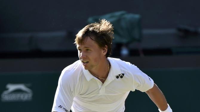 Ricardas Berankis of Lithuania serves during his match against Marin Cilic of Croatia at the Wimbledon Tennis Championships in London