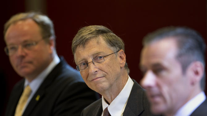 Bill Gates, center, founder of the software company Microsoft, attends a joint press conference with German Development Aid Minster Dirk Niebel, left, and the CEO of Bayer CropScience, Liam Condon, right, after a meeting in Berlin, Germany, Tuesday, Jan. 29, 2013. (AP Photo/Michael Sohn)