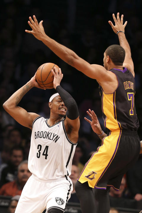 Brooklyn Nets small forward Paul Pierce (34) looks to pass against Los Angeles Lakers small forward Xavier Henry (7) in the second half of an NBA basketball game at the Barclays Center, Wednesday, Nov