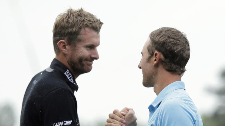 Derek Ernst, right, is congratulated by David Lynn, left, after winning the Wells Fargo Championship golf tournament at Quail Hollow Club in Charlotte, N.C., Sunday, May 5, 2013. Ernst defeated Lynn after making par on the first playoff hole. (AP Photo/Chuck Burton)