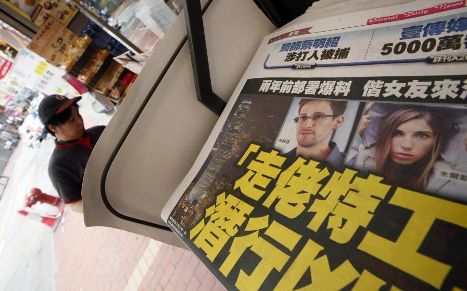 The picture of Edward Snowden, former CIA employee who leaked top-secret documents about sweeping U.S. surveillance programs, is displayed on the front page of a newspaper in Hong Kong Wednesday, June 12, 2013. The whereabouts of Snowden remained unknown Wednesday, two days after he checked out of a Hong Kong hotel. (AP Photo/Kin Cheung)