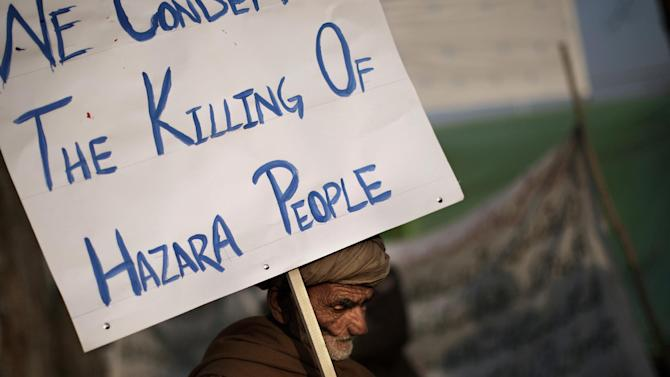 An elderly Pakistani man holds a banner while taking part in a protest condemning the bombing attack that took place in Quetta last Saturday, in Islamabad, Pakistan, Monday, Feb. 18, 2013. The families of scores of victims of the bombing in Quetta have refused to bury their relatives until authorities take action against the militants who were responsible. (AP Photo/Muhammed Muheisen)