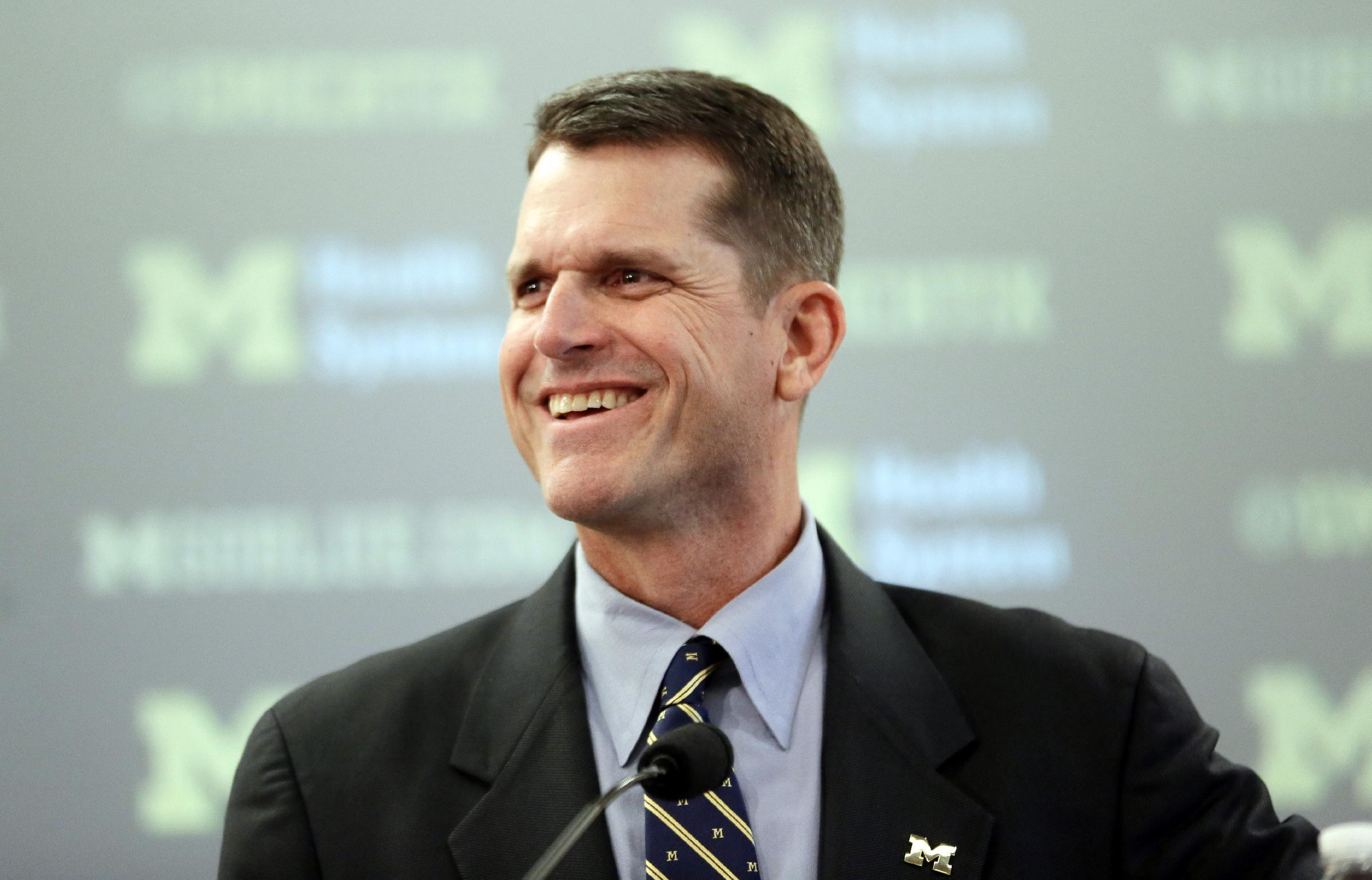 Michigan coach Jim Harbaugh assists car crash victims