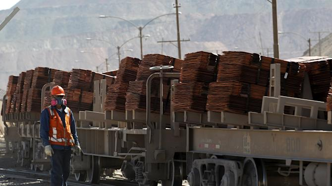 An operator monitors a train where copper cathodes are loaded for shipping to a port, at the Chuquicamata mine
