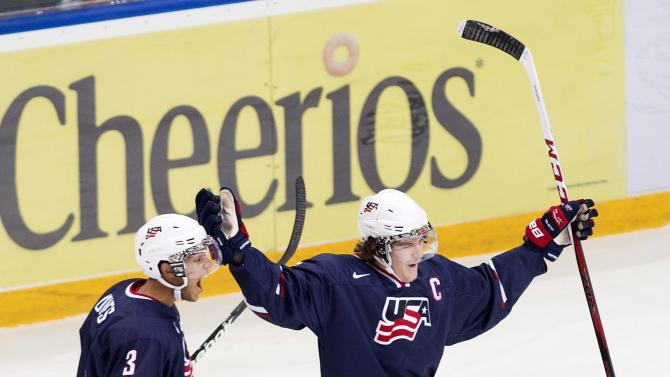 Team USA forward Jake McCabe, right, celebrates a goal with teammate Seth Jones, left, during first period semi-final IIHF World Junior Championships hockey action in Ufa, Russia on Thursday, Jan. 3, 2013. (AP Photo/The Canadian Press, Nathan Denette)