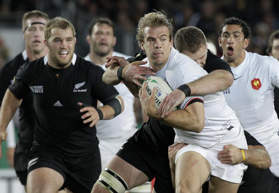 France's Aurelien Rougerie is tackled by New Zealand All Blacks Kieran Read during their Rugby World Cup final at Eden Park in Auckland, New Zealand, Sunday, Oct. 23, 2011. (AP Photo/Themba Hadebe)