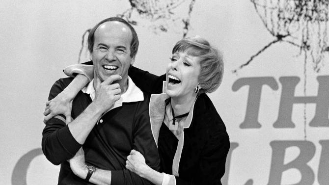 FILE - In this March 19, 1978 black-and-white file photo, Carol Burnett shares a laugh with Tim Conway during taping of her final show , in Los Angeles. Burnett, who honed her humor on Broadway and landed her own comedy show on television in 1967, will win the nation's top humor prize. The Kennedy Center for the Performing Arts announced Tuesday that Burnett will receive the Mark Twain Prize for American Humor on Oct. 20 in Washington. A gala performance featuring top names in comedy will be taped and broadcast nationally Oct. 30 on PBS.  (AP Photo/ George Brich, File)