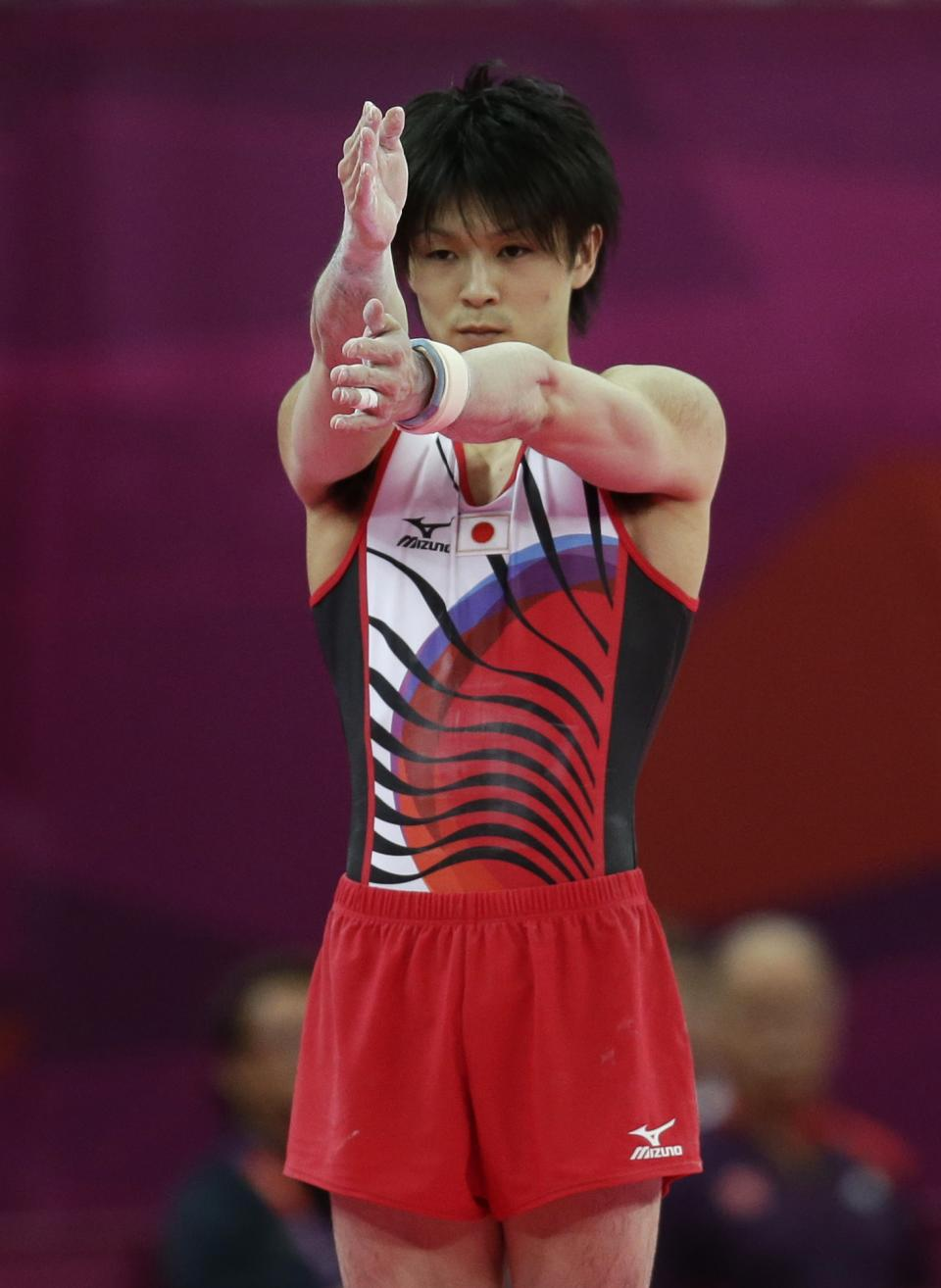 Japanese gymnast Kohei Uchimura measures his run prior to his vault exercise during the Artistic Gymnastics men's qualification at the 2012 Summer Olympics, Saturday, July 28, 2012, in London. (AP Photo/Gregory Bull)