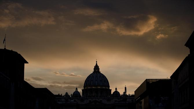 A large screen for public display shows Pope John Paul II after sunset outside St. Peter's Square at the Vatican, Saturday, April 26, 2014. Pilgrims and tourists streamed into Rome on Saturday to participate in the ceremony in St. Peter's Square that will see two popes, John XXIII and John Paul II, be proclaimed saints. (AP Photo/Vadim Ghirda)