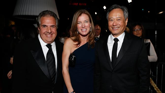 From left, Co-Chairman and CEO, Fox Flmed Entertainment Jim Gianopolous, Ann Gianopulos and director Ang Lee attend the Fox Golden Globes Party on Sunday, January 13, 2013, in Beverly Hills, Calif. (Photo by Todd Williamson/Invision for Fox Searchlight/AP Images)