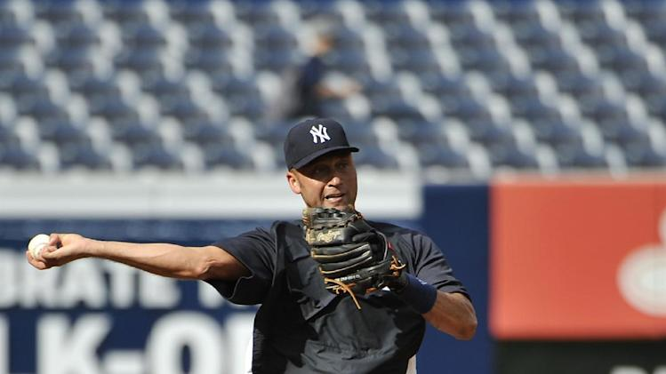 New York Yankees' Derek Jeter throws after fielding a grounder during batting practice before the Yankees' baseball against the Tampa Bay Rays at Yankee Stadium on Friday, July 26, 2013, in New York. (AP Photo/Kathy Kmonicek)