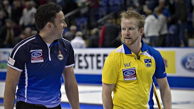 Sweden skip Niklas Edin (R) jokes with Scotland skip David Murdoch after their page playoff game at the World Men's Curling Championships in Victoria, British Columbia (Reuters)