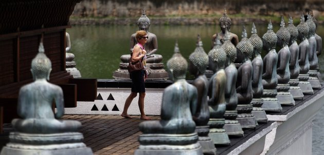 A tourist walks at the Gangaramaya Buddhist temple in Colombo