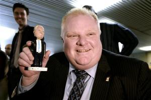 Toronto Mayor Rob Ford shows off his bobblehead doll at City Hall in Toronto
