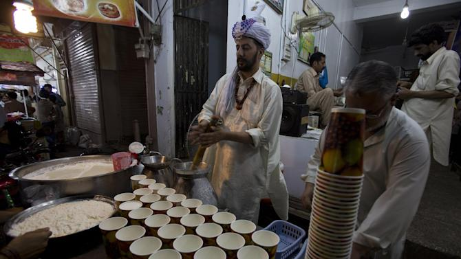 A Pakistani vendor prepares lassi made of milk for 'sehri', the pre-dawn meal for Muslims observing Ramadan, in Rawalpindi, Pakistan, Tuesday, July 7, 2015. Muslims across the world are observing the holy fasting month of Ramadan, where they refrain from eating, drinking and smoking from dawn to dusk. (AP Photo/B.K. Bangash)