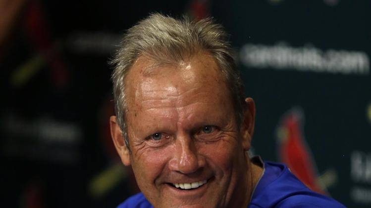 Kansas City Royals' George Brett laughs during a news conference announcing him as the Royals' interim hitting coach before a baseball game against the St. Louis Cardinals, Thursday, May 30, 2013, in St. Louis. (AP Photo/Jeff Roberson)
