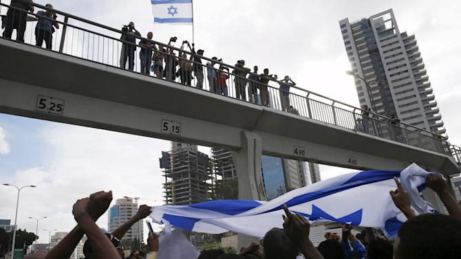 Protesters, mainly who are Israeli Jews of Ethiopian origin, block a main road in Tel Aviv during a demonstration against what they say is police racism and brutality