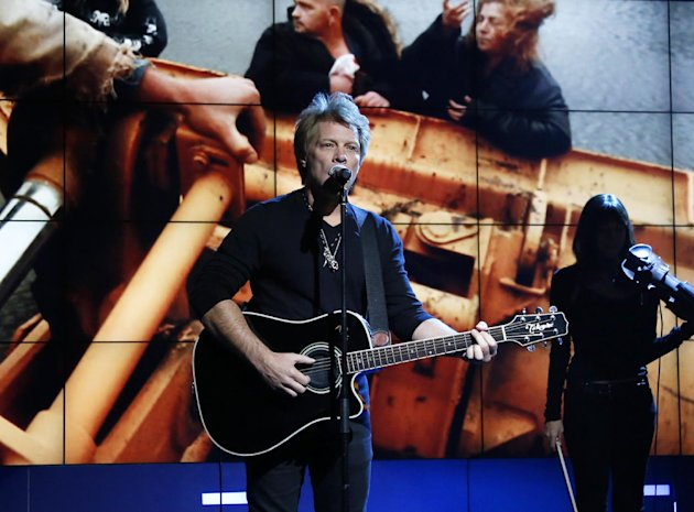 FILE - In this Nov. 2, 2012, photo provided by NBC, Jon Bon Jovi performs in New York, during &quot;Hurricane Sandy: Coming Together,&quot; a concert hosted by NBC to raise money for victims of Superstorm Sandy. Bon Jovi and Bruce Springsteen Springsteen are among the New Jersey natives joining a special fund created in the wake of Superstorm Sandy. The musicians will serve on the advisory board of the Hurricane Sandy New Jersey Relief Fund. The nonprofit was created by state first lady Mary Pat Christie to aid in the long-term recovery effort following the storm. The board has raised more than $16 million, so far. (AP Photo/NBC, Heidi Gutman, file)