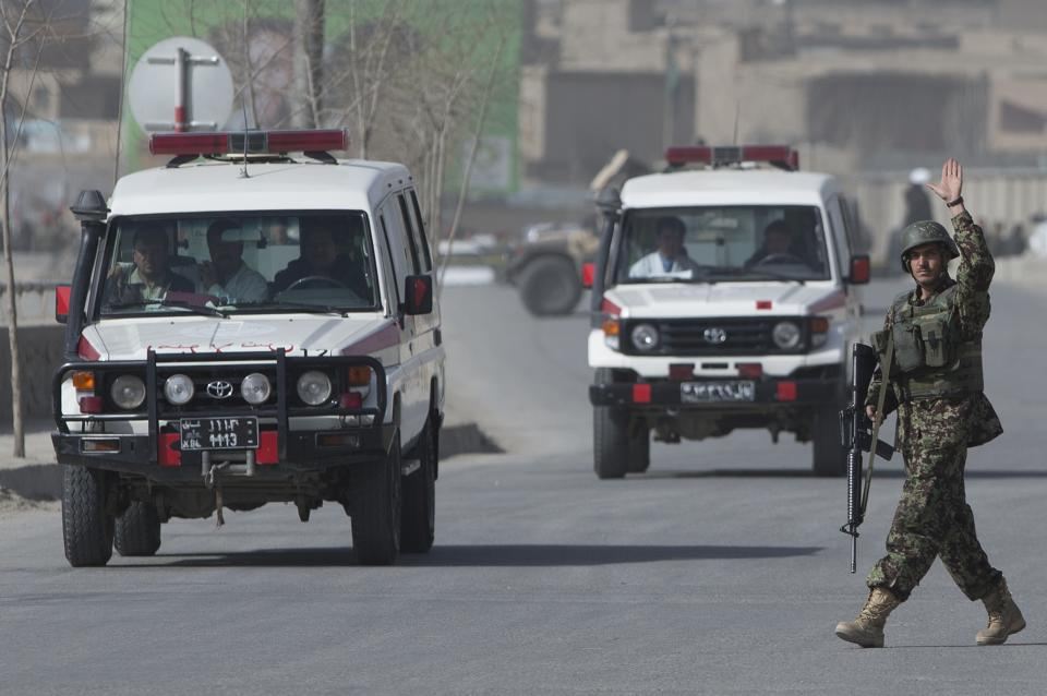 Ambulances arrive outside the Afghan Defense Ministry after a suicide bomber on a bicycle struck outside the ministry, killing at least nine Afghan civilians as U.S. Defense Secretary Chuck Hagel visited Kabul, Afghanistan, Saturday, March 9, 2013.  (AP Photo/Anja Niedringhaus)