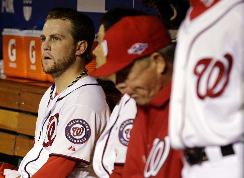 Washington Nationals relief pitcher Drew Storen, left, looks on from the dugout after Game 5 of the National League division baseball series against the St. Louis Cardinals on Saturday, Oct 13, 2012, in Washington. St. Louis won 9-7. (AP Photo/Alex Brandon)