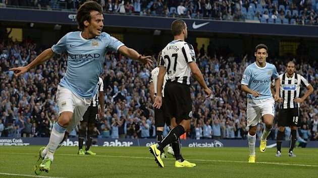 Manchester City's David Silva (L) celebrates scoring against Newcastle United