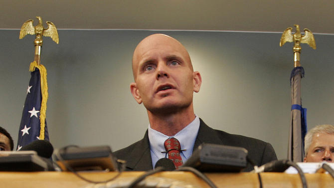 In this July 27, 2005 photo, FBI Agent Frederick Humphries speaks during a news conference after the sentencing of Ahmed Ressam at the Federal Courthouse in Seattle. Humphries has been identified as the agent socialite Jill Kelley contacted to complain about harassing emails sent by Gen. David Petraeus' paramour, Paula Broadwell.  (AP Photo/Kevin P. Casey)