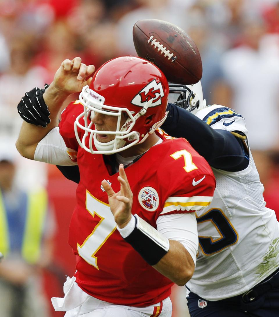 Kansas City Chiefs quarterback Matt Cassel (7) fumbles as he is hit by San Diego Chargers outside linebacker Shaun Phillips (95) during the first half of an NFL football game at Arrowhead Stadium in Kansas City, Mo., Sunday, Sept. 30, 2012. (AP Photo/Ed Zurga)