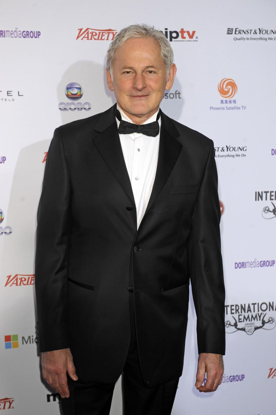 Actor Victor Garber arrives at the 40th International Emmy Awards,  Monday, Nov. 19, 2012 in New York.  (AP Photo/Henny Ray Abrams)