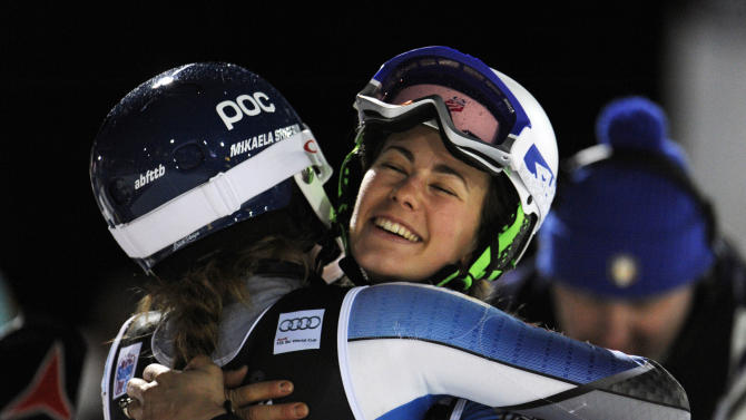 Mikaela Shiffrin, of the United States, back to camera, celebrates with her teammate Resi Stiegler after winning an alpine ski, women's World Cup slalom, in Zagreb, Croatia, Friday, Jan. 4, 2013. (AP Photo/Giovanni Auletta)