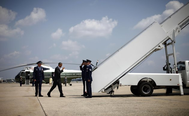 President Barack Obama prepares to board Air Force One before his departure from Andrews Air Force Base, Md.,Thursday, Aug., 2, 2012. Obama is campaigning in Florida and Northern Virginia today. (AP Photo/Pablo Martinez Monsivais)