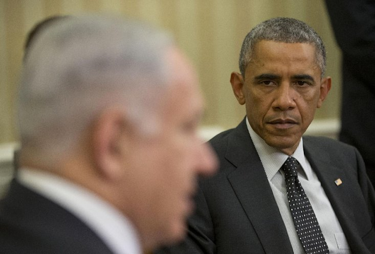 President Barack Obama listens as Israeli Prime Minister Benjamin Netanyahu speaks during their meeting in the Oval Office of the White House in Washington, Wednesday, Oct. 1, 2014. (AP Photo/Pablo Martinez Monsivais)