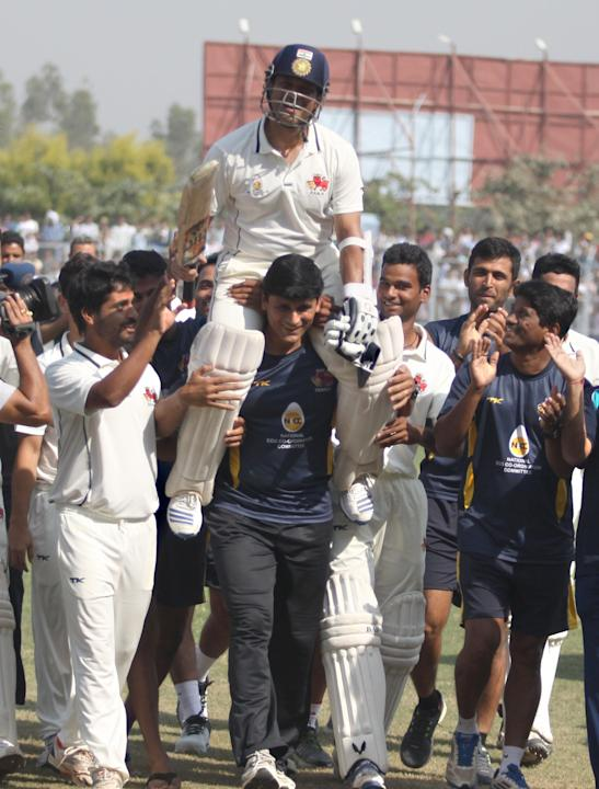 Players lift master blaster Sachin Tendulkar after Mumbai won the Ranji Trophy match between Haryana and Mumbai played at Bansi Lal Cricket Stadium in Rohtak on Oct.30, 2013. This was Sachin's far